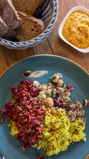 Curry Couscous, beetroot, beans and tuna with yellow hummus and bread