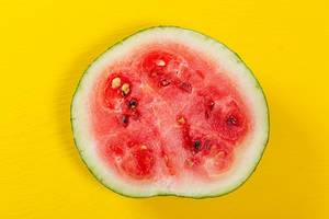 Cut watermelon on a yellow background
