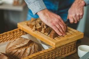 Cutting  Dark Bread Slices  On Wooden Board (Flip 2019)