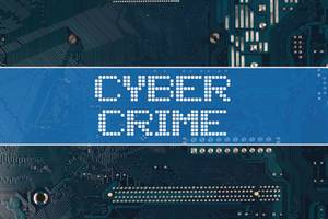Cyber Crime text over electronic circuit board background