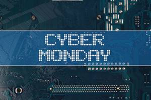 Cyber Monday text over electronic circuit board background