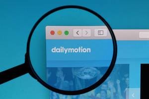 Dailymotion logo under magnifying glass