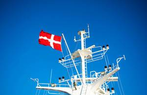 Danish flag waving on a ferry