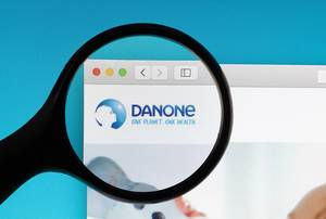 Danone logo under magnifying glass