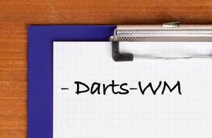 Darts-WM als Text auf einem Klemmbrett geschrieben