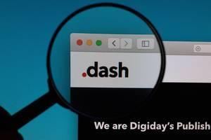 Dash logo under magnifying glass