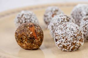Dates and Peanut Butter energy balls cookies on the plate (Flip 2019)