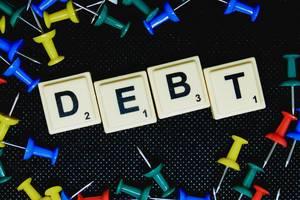 Debt text flatlay shot