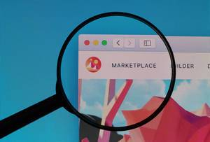 Decentraland Marketplace logo under magnifying glass