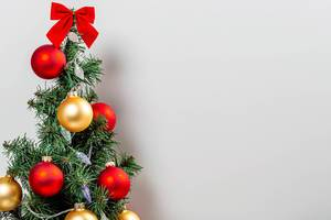 Decorated Christmas tree on white background with free space (Flip 2019)