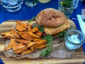 Deep fried Halloumi Burger at Augustin in Vienna: halloumi, arugula, red onions, tomatoes, dijonnaise, sweet potato fries, yoghurt-mint dip
