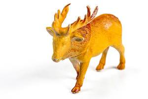 Deer plastic figure on a white background