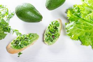 Delicious and healthy food with green sandwiches, avocado and lettuce (Flip 2019)