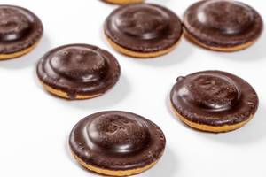 Delicious cookies with marmalade and chocolate icing