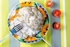 Delicious homemade chicken ham with Cutlery