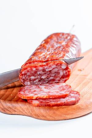 Delicious sliced sausages on table  Flip 2019