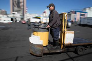 Deliveryman at the fish market in Tokyo