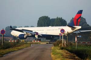 Delta Air Lines plane landing at Amsterdam Airport, AMS