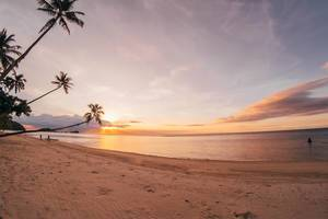 Der Strand in Punta Bulata bei einem romantischem Sonnenuntergang