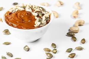 Dessert with condensed milk, cashew nuts and pumpkin seeds (Flip 2019)