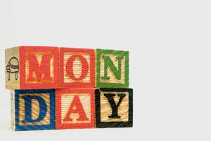 Detail shot of wooden blocks with Monday text