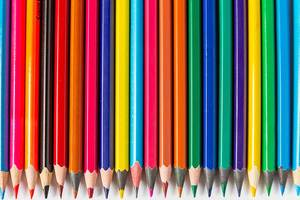 Detailed view of colored pencils in a row