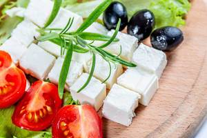 Diced feta cheese with tomatoes and olives  Flip 2019