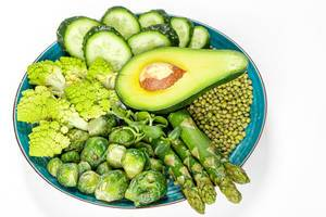 Diet food concept, green fresh vegetables and mung beans in a plate on a white background (Flip 2020)