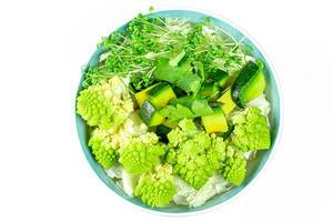 Diet green salad on a white background. The view from the top (Flip 2020)
