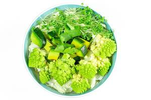 Diet green salad on a white background. The view from the top