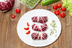 Dietary stuffed salad chicory Radicchio with vegetables and micro greenery (Flip 2019)