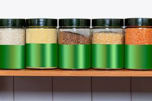 Different groats in glass jars on the shelf (Flip 2020)