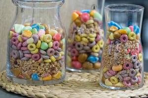 Different kinds of breakfast cereals in glass containers