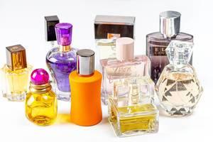 Different perfume bottles on light background (Flip 2020)