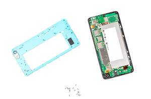 Disassembled smartphone with cover and screws on a white background (Flip 2020)