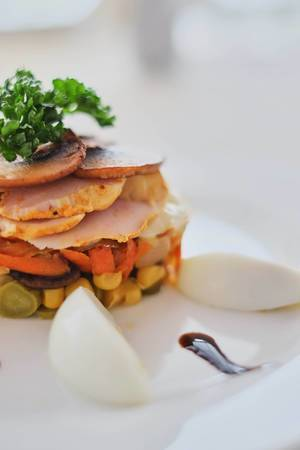 dish with mushrooms ham carrots and corn with eggs side view  Flip 2019
