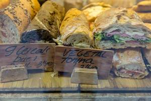 Diverse country-stil breads with salad, sausage, cheese and vegetables in Barcelona, Spain