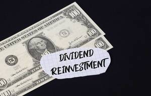 Dividend Reinvestment text and dollar banknotes