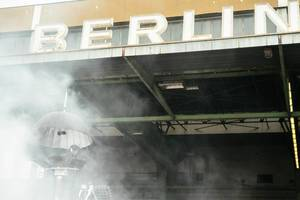 DJ in smoke in front of the huge BERLIN sign