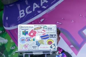 DJ with 90s Stickers on Macbook at Fibo in Cologne, Germany