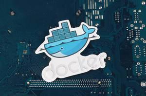 Docker logo over electronic circuit board background
