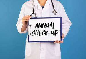 Doctor holding clipboard with Annual Check-up text