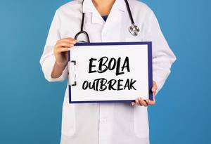 Doctor holding clipboard with Ebola outbreak text