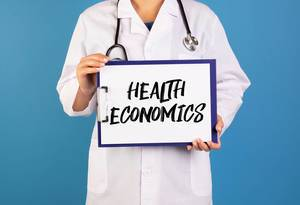 Doctor holding clipboard with Health Economics text