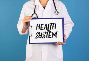 Doctor holding clipboard with Health system text