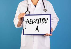 Doctor holding clipboard with hepatitis A text