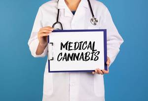 Doctor holding clipboard with Medical Cannabis text