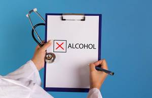 Doctor with prescription stop drinking alcohol
