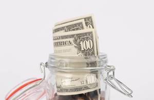 Dollar bills in glass jar