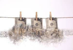 Dollar bills with smoke hanging on a clothes line